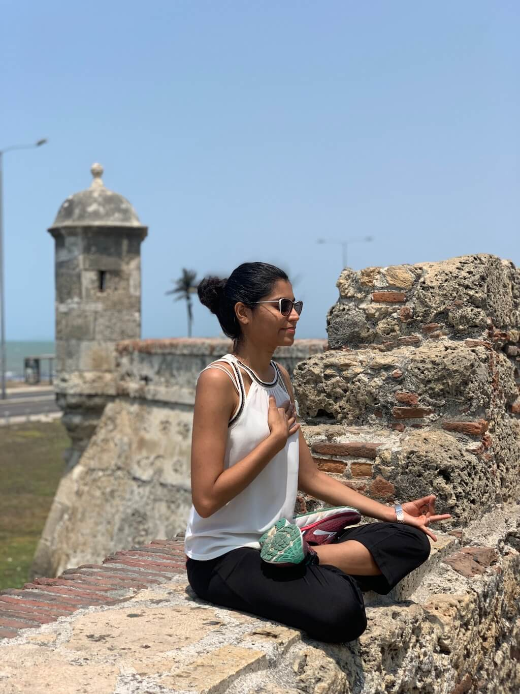 Meditating with the ocean backdrop at the Cartagena old-city wall